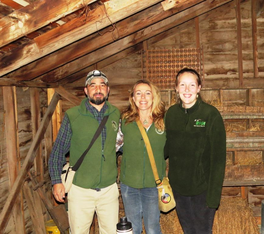 Author (center), Ethan Duke, co-founder & director of MRBO, and Education Coordinator Paige Witek in the Northern Saw-whet Owl banding shed