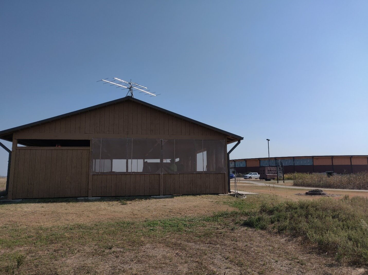 Photo of a Motus station on top of a Picnic shelter at the Kansas Wetlands Education Center at Cheyenne Bottoms Wildlife Area, in central Kansas.